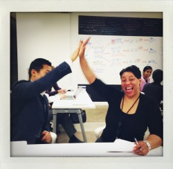 Two people high fiving at a usability training