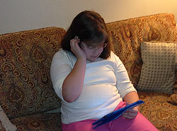 250 x 185 - girl reading on tablet - six new changes in kids media habits