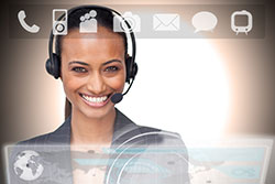 Beautiful smiling businesswoman using futuristic interface showing applications