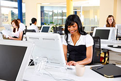 Young call center staff working in modern open office