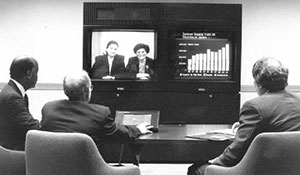 GAO employees using teleconferencing in modernized space in a regional office 1980s