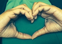 Image of hands in the shape of a heart