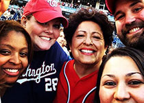 Photo of OPM Director and other Federal Employees at the Nationals Baseball game