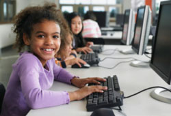 Young kids at computers