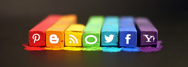 Social media icons on the ends of brightly colored chalk