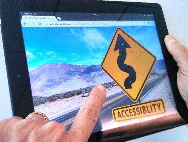 An accessibility road sign displayed on an iPad.