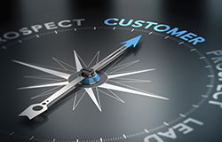 Business Concept compass graphic with the arrow pointing towards Customer
