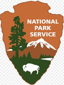 National Park Service logo of an arrowhead with mountain, tree and buffalo