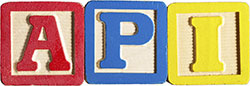Children's building blocks letters spelling A P I.