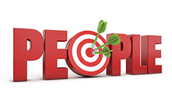 A concept graphic for targeting people: the word people is in 3-D red lettering, with the o is a dart board with 3 green darts