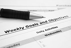 A photo of a Weekly Goals and Objectives daily calendar