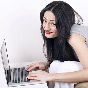 A young woman uses a laptop computer.