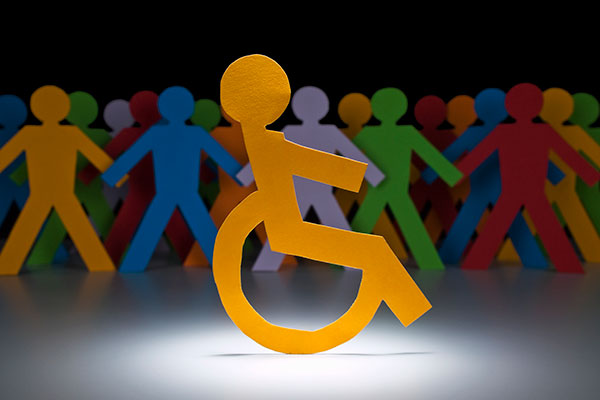 Disabled paper figure in crowd