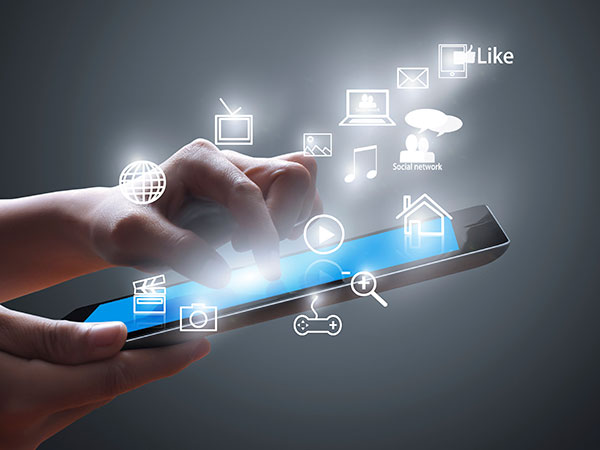concept image of a mobile tablet being used for a variety of tasks; television, movies, games, music, email, social networks, et cetera.