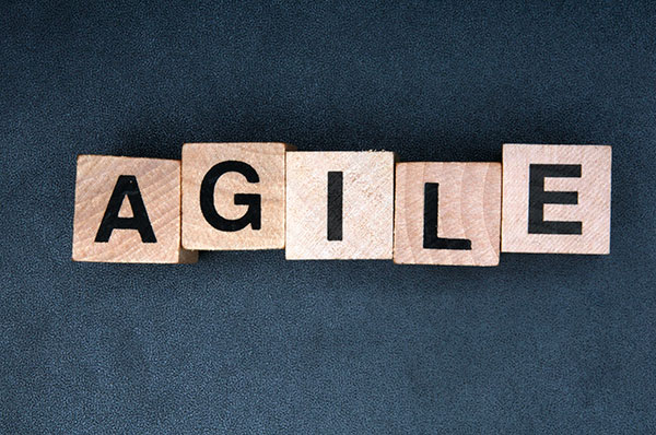 Wooden letter blocks spell out the word agile.