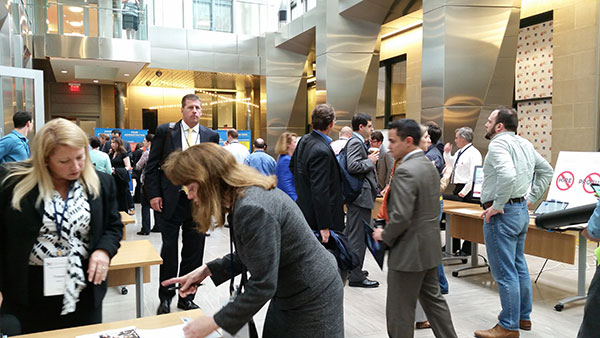 2014 Summit Expo tables and crowd of attendees