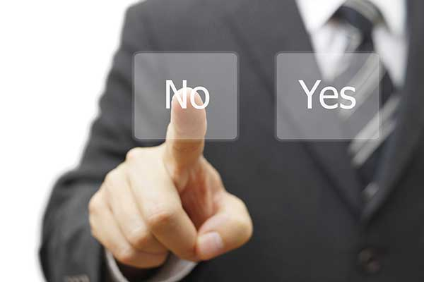 Businessman choosing no instead yes button