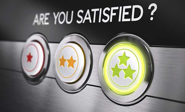 The question, Are you satisfied? appears on a console above 3 rating buttons; 1 star to indicate not satisfied, 2 stars to indicate somewhat satisfied, and 3 stars, which has been selected, to indicate very satisfied.