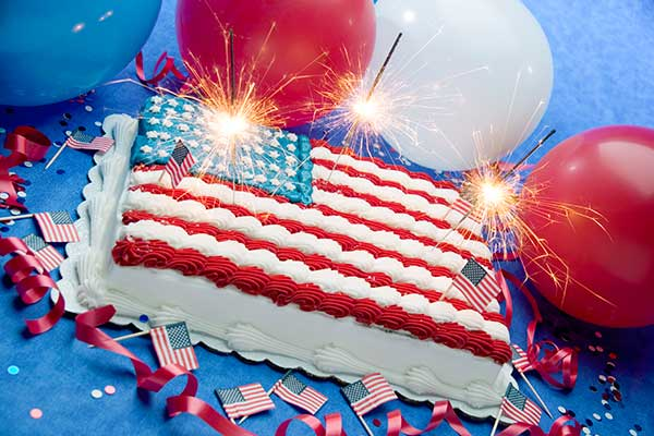 Cake with American flag frosting and sparkling candles