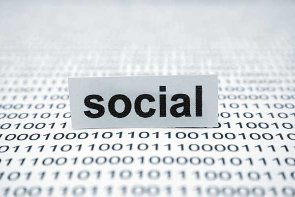 Social data concept graphic; the word social on a card that is surrounded by binary ones and zeroes