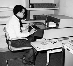 FEC staff scanning compliance forms, 1982