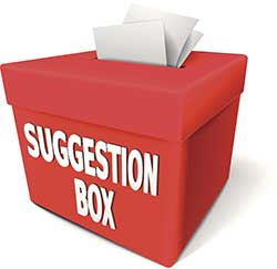 A suggestion box with papers sticking out of the slot