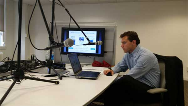 Ben Bain of XPRIZE listens to colleague during the DGU webinar
