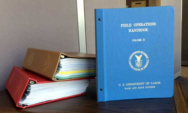 Three large binders of the Field Operations Handbook
