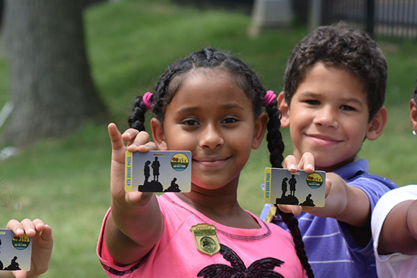 Students from Samuel W. Tucker Elementary School receive an Every Kid in a Park pass.