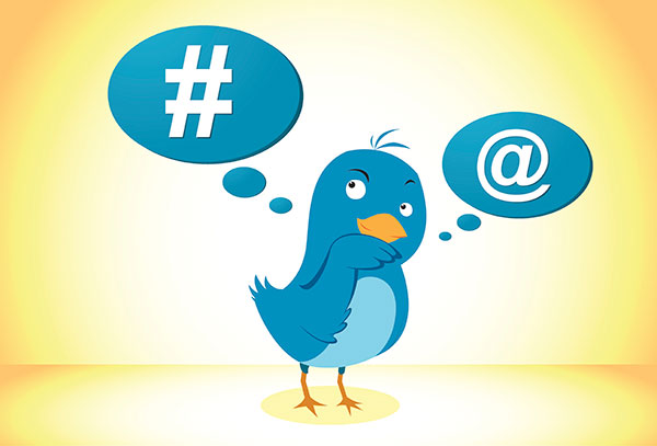 An illustration of a blue bird icon that is thinking about hashtag and the at symbol