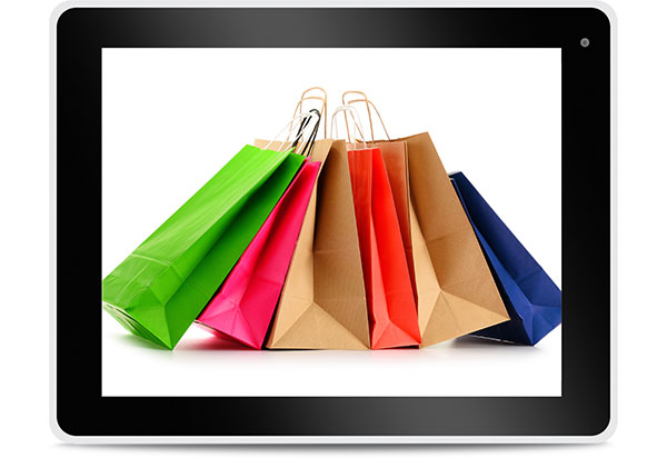 Paper shopping bags on computer tablet screen