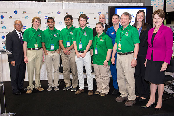 NASA's Administrator, Charles Bolden (left), Marillyn Hewson, President/CEO of Lockheed Martin (right), and astronaut Rex Walheim (back) stand with Team ARES, from the Governors School for Science and Technology in Hampton, Va., winners of the Exploration Design Challenge high school competition.