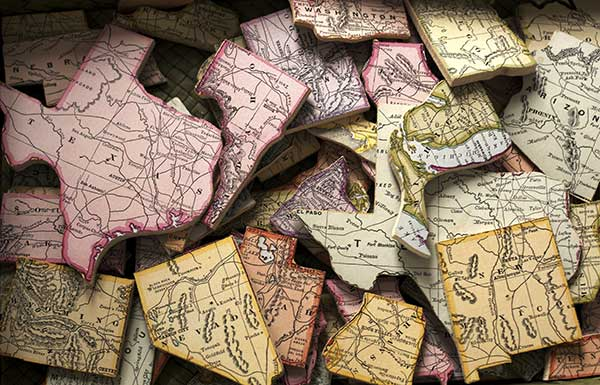 A United States road map, shown as a pile of puzzle pieces of each state