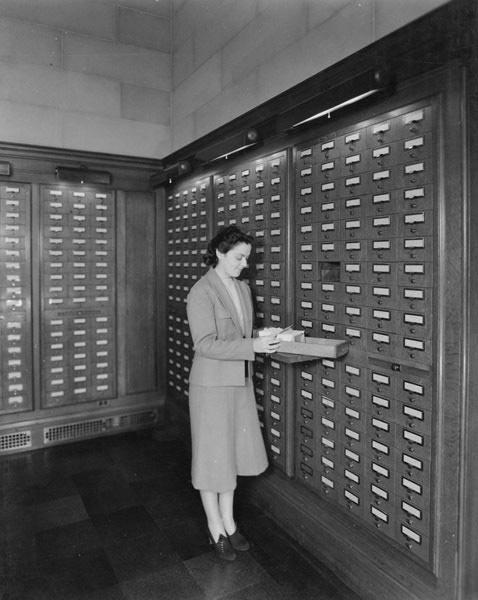 "Use the U.S. Digital Registry to find the government services you need. Photo: ""Card catalog in Central Search Room, July 31, 1942."" Record Group 64: Records of the National Archives and Records Administration. https://catalog.archives.gov/id/3493244"