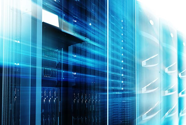 Mainframes cluster with control terminal in data center with a motion blur filter.