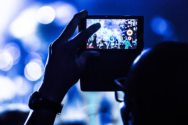 Concert mobile bokeh blue unrecognizable