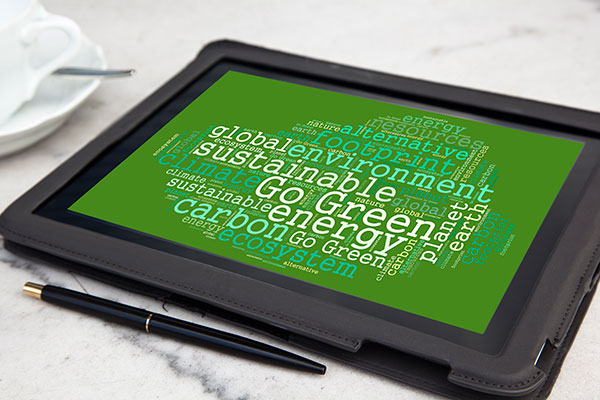 Tablet with go green word cloud.