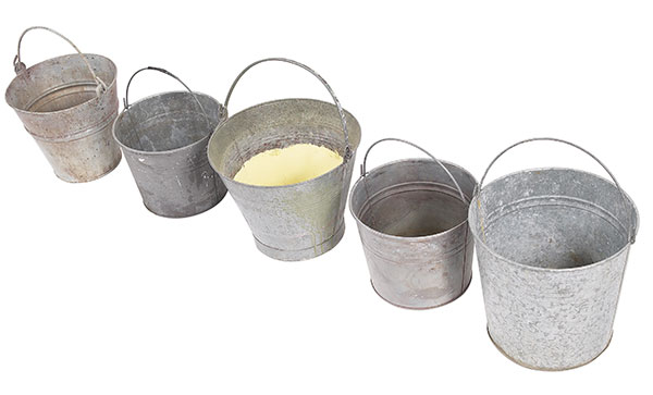 Five metal buckets in a row.