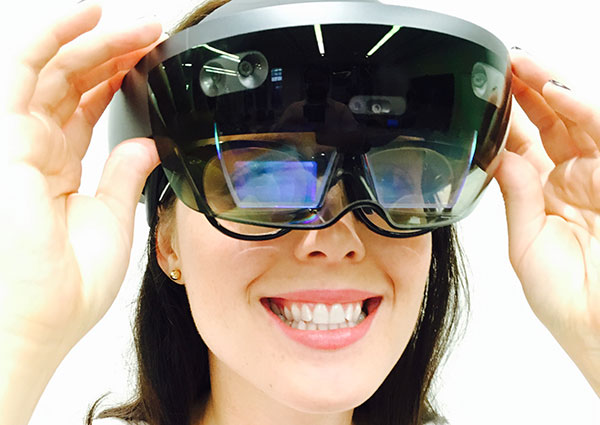 Lindsey Teel, policy advisor at U.S. Department of Labor and advocate for greater accessibility for persons with disabilities, tests Microsoft's Hololens mixed reality device for improving access to training and educations services for citizens with vision impairments.
