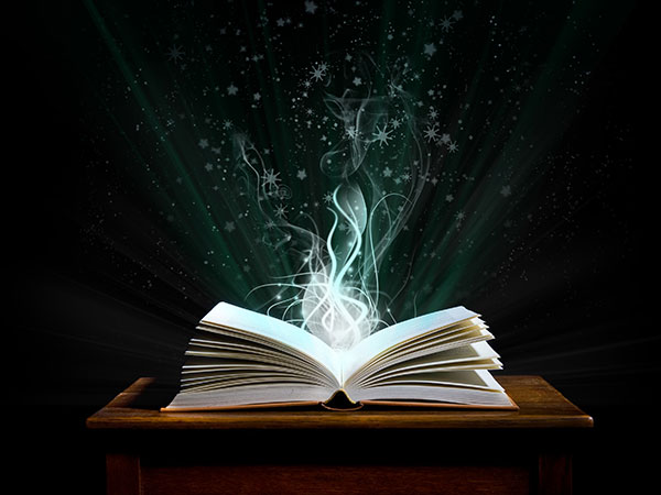 An open book with wisps of light.