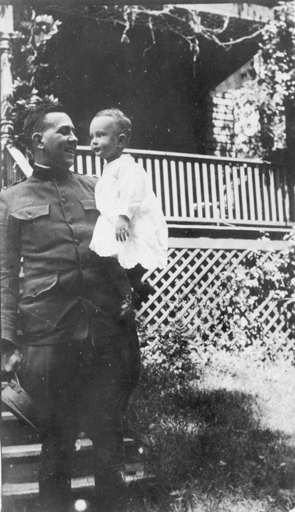 Captain Timothy Barber with his son.