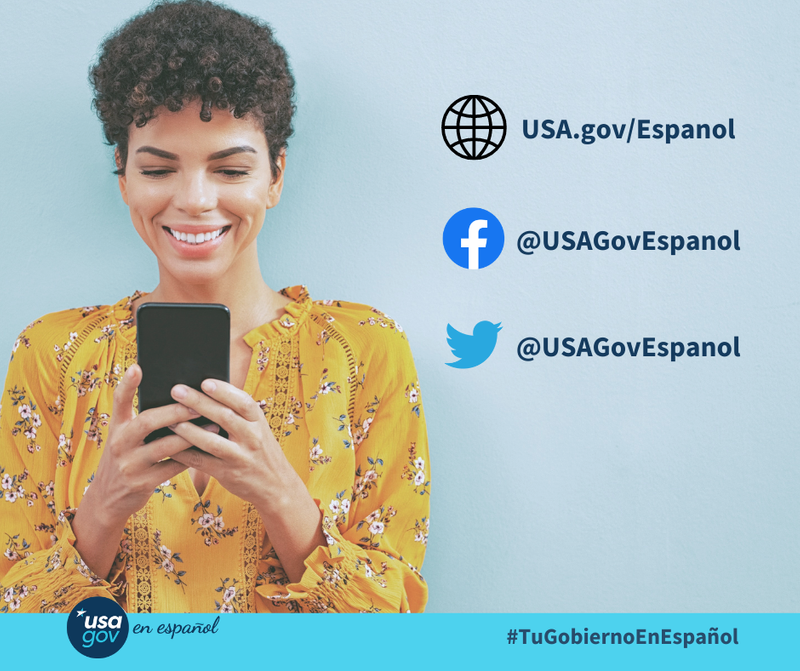 On the left side of a square graphic with a light blue background, a woman smiles while looking at a cell phone in her hands. On the right are three lines of dark blue text with an icon. First is a globe with the URL, USA.gov/Espanol, The secondl ine has the Facebook icon and the handle @USAGovEspanol. The third line has the Twitter ison and the same handle; @USAGovEspanol. Along the bottom is a banner in another shade of blue. on  the left is the USAGov en Español logo, and on the right is the hashtag, #TuGobiernoEnEspañol.