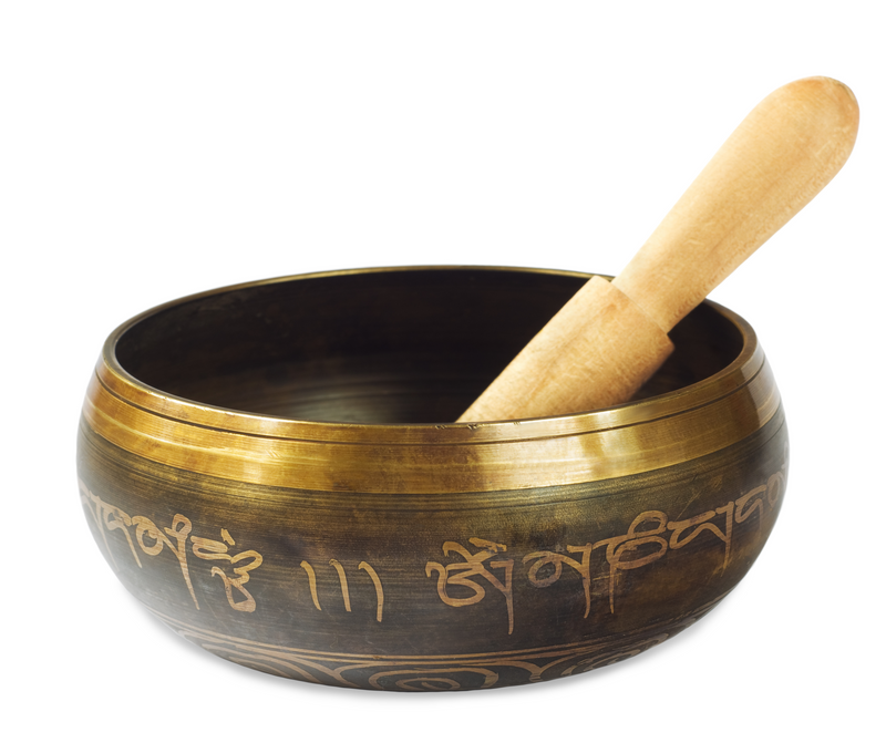 A photograph of a metal meditation singing bowl.