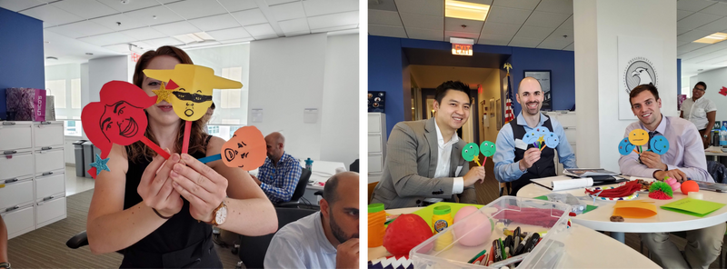 Two side-by-side photos show participants in the Data is Coming: Prototyping Engagement Workshops for the Future of Federal Data, Dashboards, and Storytelling event in July 2019. Three people in the first photo and one person in the second photo hold different emoji faces of various designs and colors in their hands. The hand-held emojis were created for an interactive engagement experience so that participants could vote on data dashboard effectiveness at the Presidential Innovation Fellows workspace in Washington, DC.