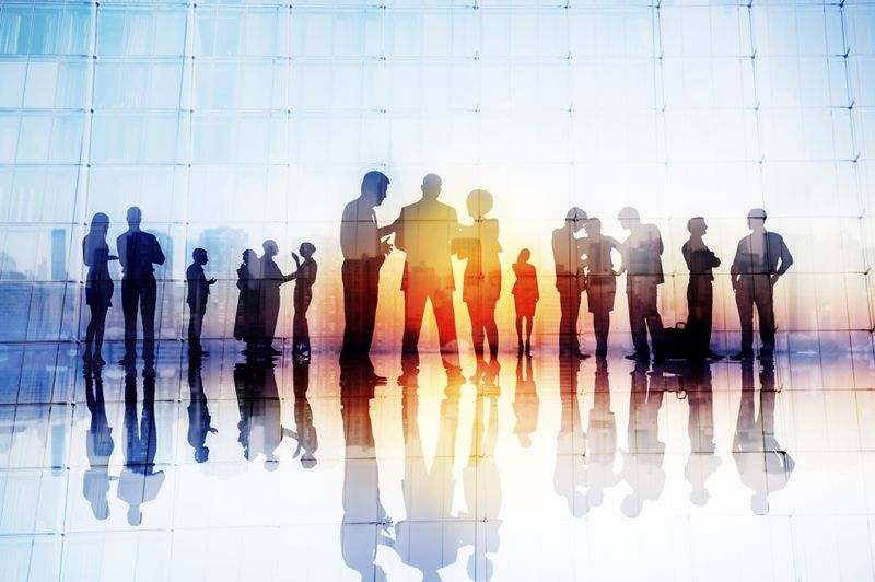 Silhouettes of business people having discussions