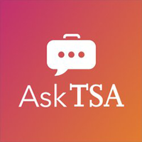 This logo has Ask TSA in white text below a white chat icon with a handle along the top of it, on a redish-orange background.