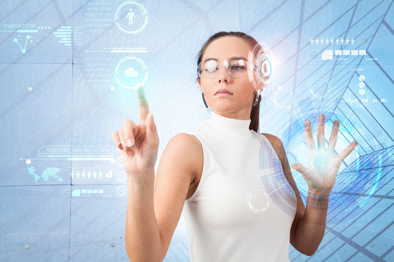 Woman touching a virtual interface.