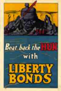 A World War I poster reads, Beat back the Hun with Liberty Bonds.