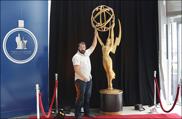 Justin Rondeau posing with the Emmy Statue at Content & Commerce Summit 2017