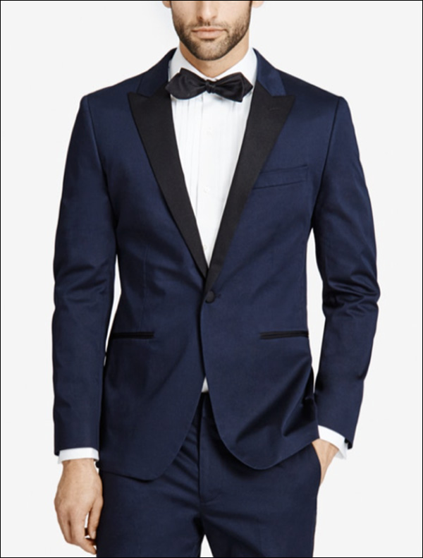 A man modeling a navy blue suit